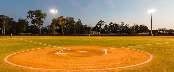 a baseball field with a light post